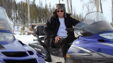 Anthony Melchiorri snowmobiling in Grand Lake