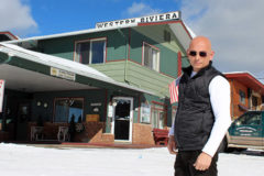 Anthony poses in front of the Western Riviera Hotel in the snowy ski town of Grand Lake, CO.