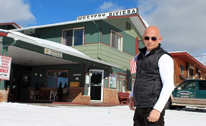 Anthony Poses In Front Of The Western Riviera Hotel Snowy Ski Town Grand