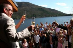 A toast with the bride & groom on the deck at Western Riviera Lakeside Venue