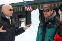 Anthony chats with a few snowmobilers in front of the hotel.