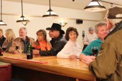 The Grand Lake townspeople get together at the hotel bar to support owners, Mike and Jackie.