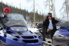 Anthony and social media expert Joel Comm learn how to snowmobile.